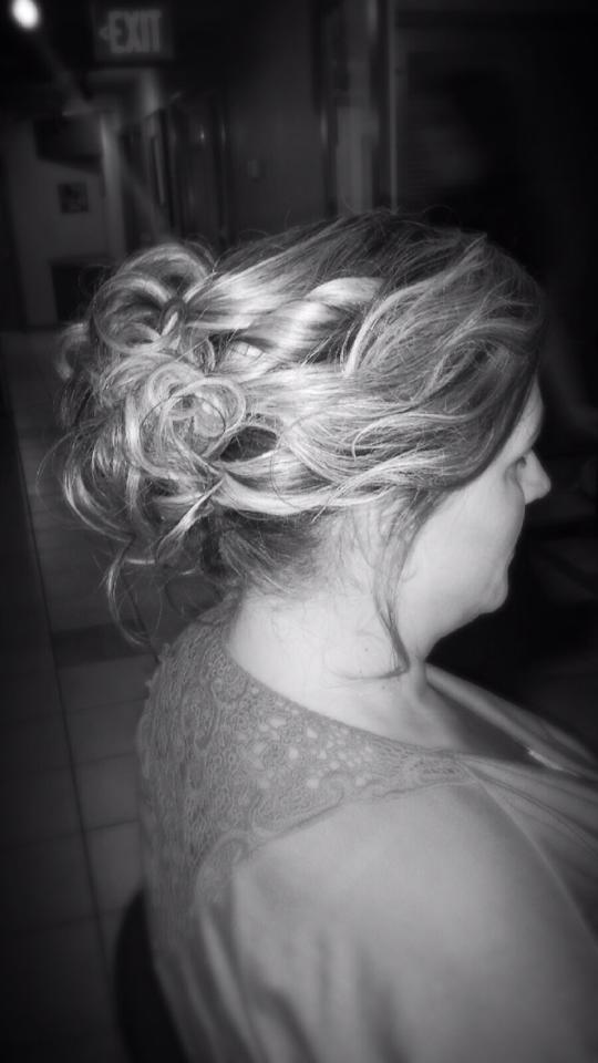 Blake & Co. Hair Salon styled the hair of the Winchester, VA, bridal show models in 2014.
